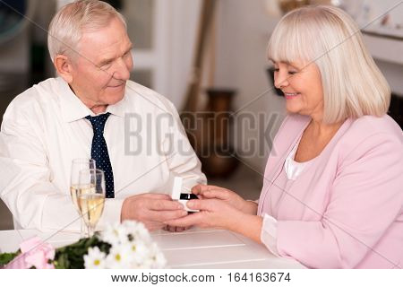 Will you be my wife. Stunning excited elderly couple sharing unforgettable moment of love during their anniversary celebration in a restaurant