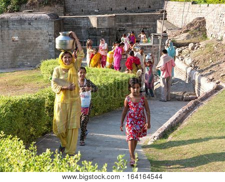 MANALI, INDIA. 4 June 2009: Rural people daily lifestyle. Hindu women carry water from the source in Manali, district Kullu in Himachal Pradesh, India.