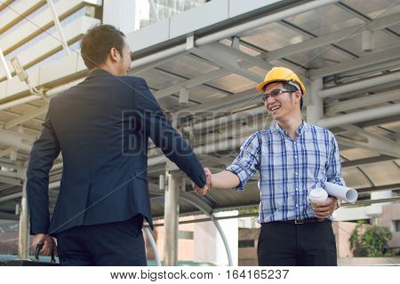 businessman worker handshaking on construction site, businessman