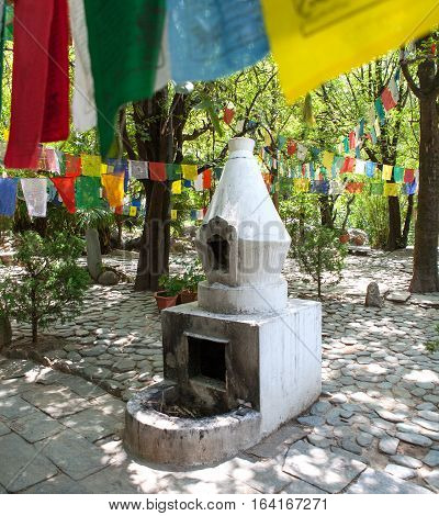 REWALSAR, INDIA. 2 June 2009: Sacred prayer flags, Buddhist stupa near the sacred lake Revalsar.  Rewalsar, district Mandi, Himachal Pradesh, district of Kangra, India.
