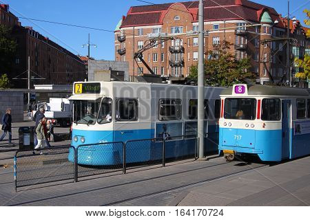 Gothenburg Sweden - Oct. 4. 2016: Transit streetcars at a main street stop in Gothenburg Sweden Scandinavia