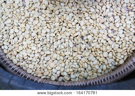Green unroasted coffee beans in the basket stock photo