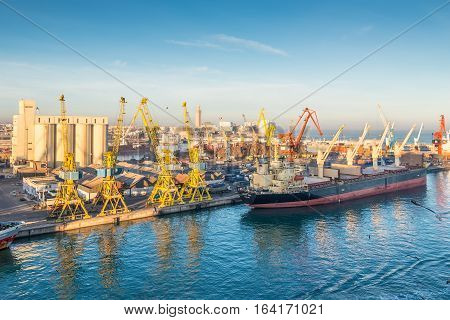 Casablanca Morocco - December 8 2016: Cargo vessel Ocean Luck (Bulk Carrier) early in the morning in the seaport of Casablanca Morocco. The scene with harbor cranes elevators ships and export cargoes in the port.