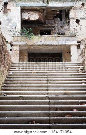 Old abandoned dilapidated building with a flight of stairs