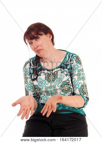 A middle age woman showing her hands empty looking very disappointed with a sad face isolated for white background.