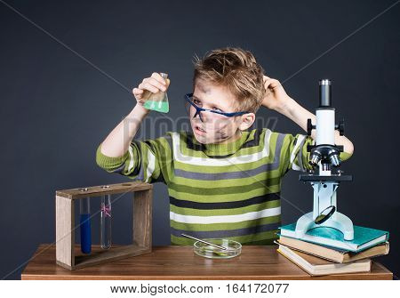 Kid making science experiments. Crazy funny dirty scientist. Education and science concept.