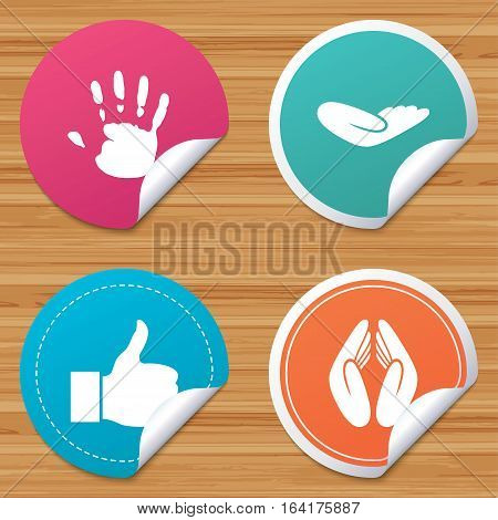 Round stickers or website banners. Hand icons. Like thumb up symbol. Insurance protection sign. Human helping donation hand. Prayer hands. Circle badges with bended corner. Vector
