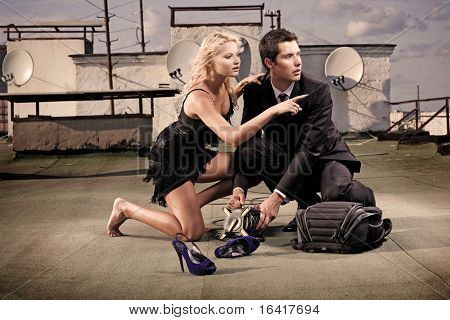 beautiful young couple on the roof poster
