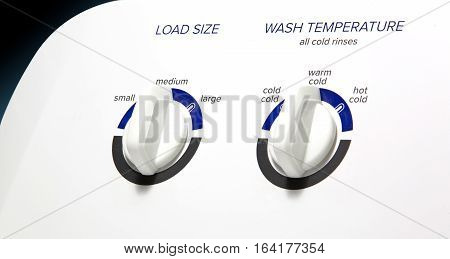 Washing Machine-Load-Temp Knobs-Angled - Clothes washer front panel with an angled view/focus on the Load Size and Temperature knobs. Straight lighting.