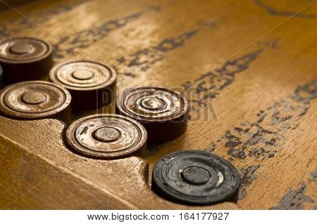 Old backgammon game photo against the light
