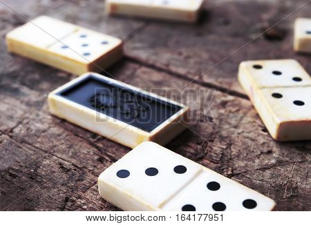 Old domino game on an wooden background