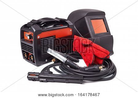 Inverter welding machine, welding equipment isolated on a white background, welding mask, leather gloves, high-voltage wires with clips, set of accessories for arc welding