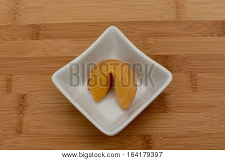 whole chinese fortune cookie in bowl on cuttingboard