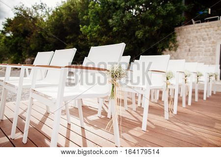 Wedding Chairs With Flowers Decoration