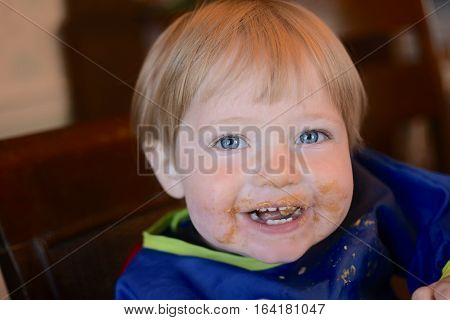 toddler baby boy with face covered in peanut butter