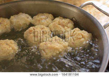 homemade matzoh ball soup simmering in pot