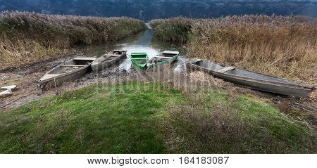 Fisher boats anchored at the riverbank. End of fishing season