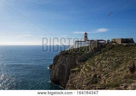 View of the Lighthouse at the Saint Vincent Cape (Cabo de Sao Vincente) in Sagres Algarve Portugal; Concept for travel in Portugal