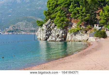 MILOCER MONTENEGRO - SEPTEMBER 17 2015: Unidentified people are relaxing on famous beach on Budva coast near island of Sveti Stefan Montenegro
