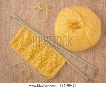 a piece of yellow mohair knit scarf