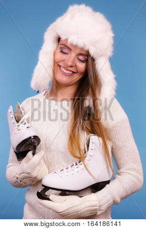 Woman Wearing Winter Hat Looking At Ice Skate