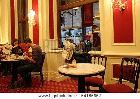VIENNA, AUSTRIA - JANUARY 2 2016: Interior of the famous Sacher Hotel bar with people around
