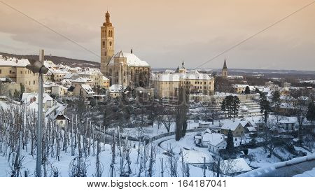 View on bohemian town Kutna Hora with St. James church snow winter
