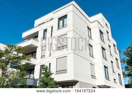 White modern multi-family house seen in Berlin, Germany