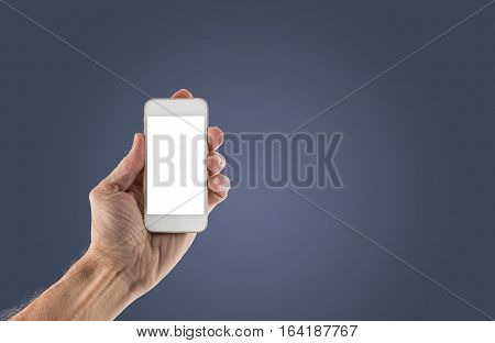 Image of male left hand holding smartphone with screen isolated ready for insertion of your application or screenshot against blue gradient background