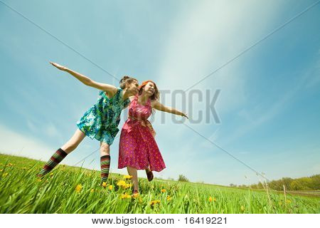 Mother and daughter with flower Having Fun under blue sky