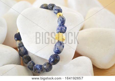 Sodalite gemstone bracelet with gold cross on white stones