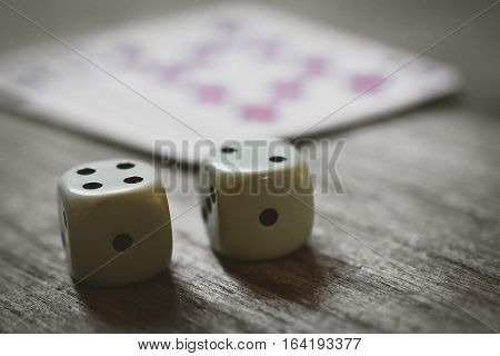 two dice closeup on on a wooden table. game risk abstract. gambling game.