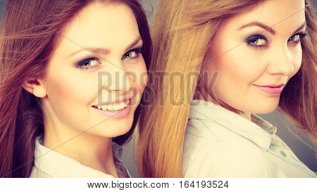 Sisterhood and siblings love. Pretty lovely charming girls together. Two positive glamorous women sisters portrait.