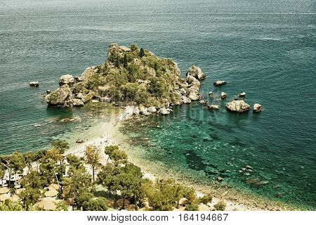 Isola Bella island Taormina in Sicily. (HDR image with black gold filter)
