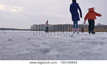 People skate on skating rink in the winter on ice, sports active winter holiday family