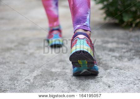 Runner Feet Running On Road Closeup On Shoes.