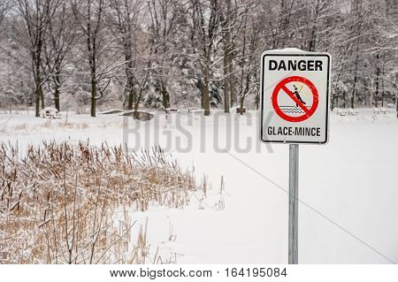 Thin Ice Warning Sign in French - Montreal Quebec Canada. (Glace Mince means Thin Ice)