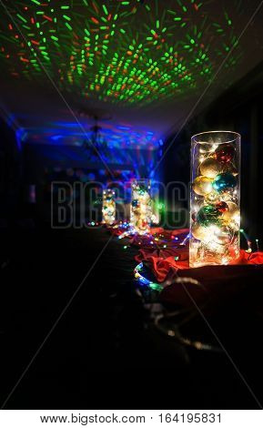 Christmas lights decorations interior home with strobe lighting on walls and ceiling bark background for copy space.