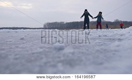 People skate on skating rink in sports the winter on ice, active winter holiday family