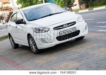 Sochi, Russia - April 29, 2016: New white Hyundai Solaris parked on the street of Sochi.