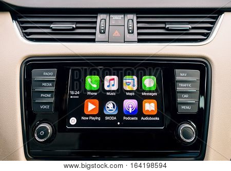 PARIS FRANCE - DEC 13 2016: Apple CarPlay main screen in modern car dashboard. CarPlay is an Apple standard that enables a car radio or head unit to be a display and controller for an iPhone. It is available on all iPhone 5 and later with at least iOS 7.1