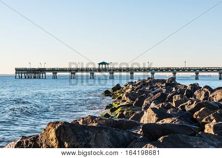 Buckroe Beach with fishing pier and rock jetty in Hampton, Virginia.