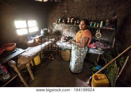 DAMBULLA, SRI LANKA. July 22, 2016: A smiling woman in her wretched home. Small village near Dambulla in southern Sri Lanka.