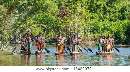 Indonesia, Irian Jaya, Asmat Province, Jow Village - June 23: Canoe War Ceremony Of Asmat People. He