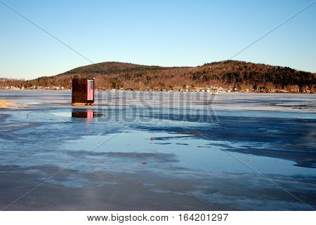 ice fishing shelter on a lake in Maine