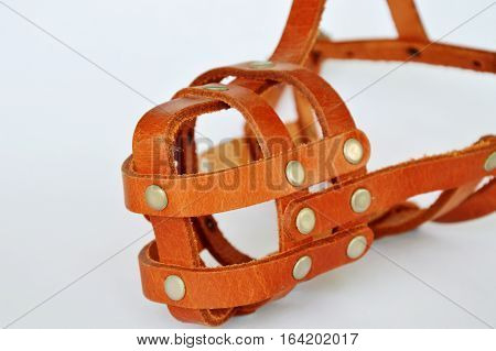 brown leather dog muzzle on white background