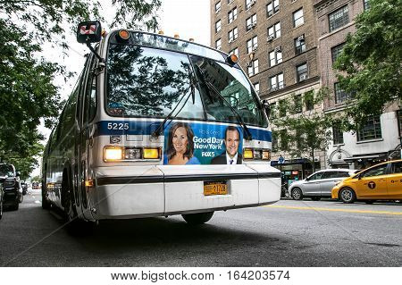 New York, September 28, 2016: An MTA bus stands idle with lights flashing in the street in Manhattan.