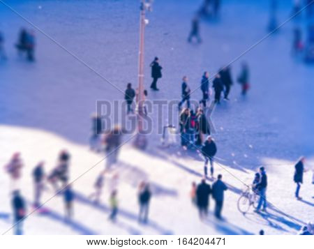 People in movement at rush hour intentionally blurred abstract background.