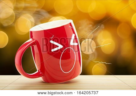 Red mug of coffee with a sleepy