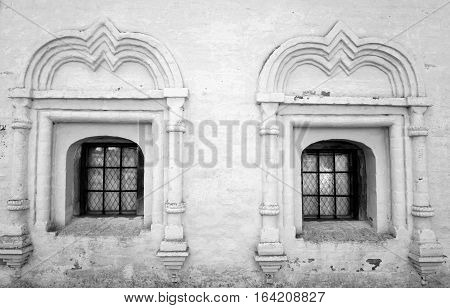 Windows of old building in Kirillo-Belozersky monastery Russsia. Black and white.